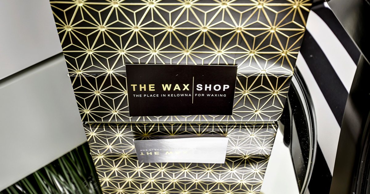 The Wax Shop logo over abstract geometric pattern